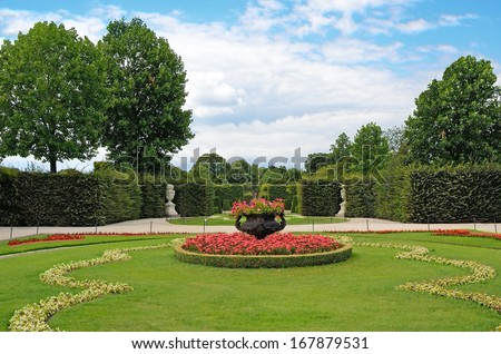 VIENNA, AUSTRIA -JULY 31: Garden of Schonbrunn Palace on July 31, 2013 in Vienna, Austria.  It was listed as a UNESCO World Heritage Site in 1996.