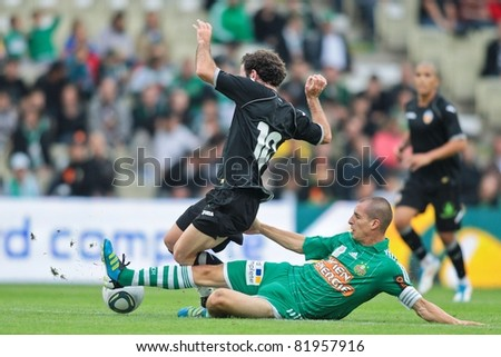 VIENNA,  AUSTRIA - JULY 26: Juan Manuel Garcia  (No. 10 Valencia) and Juergen Patocka (No. 3, Rapid) fight for the ball during the friendly soccer game on July 26, 2011 in Vienna, Austria. SK Rapid wins 4:1.