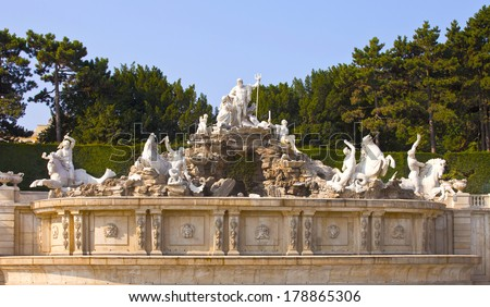 VIENNA, AUSTRIA - JULY 26,2013: View on Gloriette and Neptune fountain in Schonbrunn Palace. Schonbrunn main summer residence of Austrian emperors of a dynasty Gabsburg