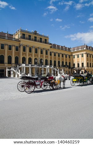 VIENNA, AUSTRIA - JUNE 23: Fiaker carriage driver waiting for tourists in front of Schonbrunn palace on June 23, 2011 in Vienna, Austria.
