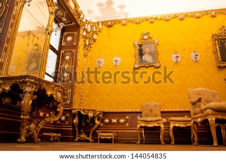 VIENNA, AUSTRIA - JUNE 3: Mirror and chairs in original 17 century cabinet inside the Austrian Museum of Applied Arts on June 3, 2013 in Vienna. The museum was founded by Emperor Franz Joseph in 1863