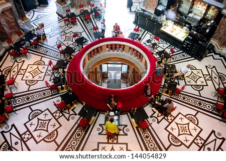 VIENNA, AUSTRIA - JUNE 6: Tourists drink coffee in historical cafe inside Kunsthistorisches Museum on June 6, 2011 in Vienna. Musem was opened in 1891. It is among 100 most visited museums worldwide