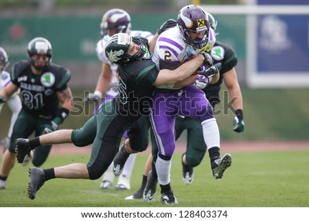 VIENNA, AUSTRIA - MARCH 31 RB Dusty Thornhill (#2 Vikings) is tackled by LB Jakob Baran (#15 Dragons) on March 31, 2012 in Vienna, Austria.