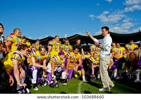 VIENNA, AUSTRIA - MAY 8 Head coach Chris Calaycay (Vikings) in the post game huddle on May 8, 2011 in Vienna, Austria. The Vienna Vikings beat the Calanda Broncos 15:12.