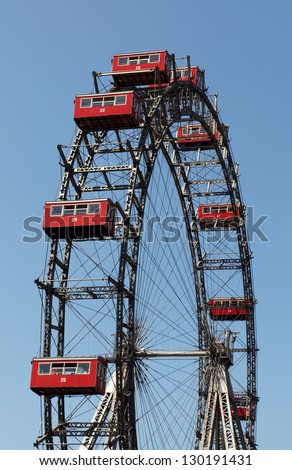 VIENNA, AUSTRIA - MAY 25: The Wiener Riesenrad (Viennese ferris wheel) erected in 1897, one of Vienna's most popular tourist attractions in Prater park on May 25, 2009. - stock photo