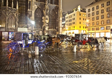 VIENNA, AUSTRIA - NOV 26:  horse drawn fiaker at the Stephans Dome  by night on November 26,2010 in Vienna, Austria. Since the 17th century, the horse-drawn carriages characterize Viennas cityscape.