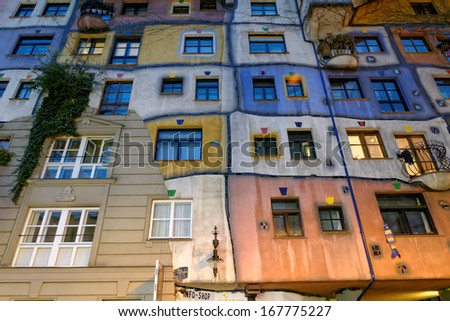 VIENNA, AUSTRIA - NOVEMBER 23: Hundertwasser Haus at night on November 23, 2013 in Vienna. The iconic building was finished in 1985 and is one of finest examples of expressionist architecture.