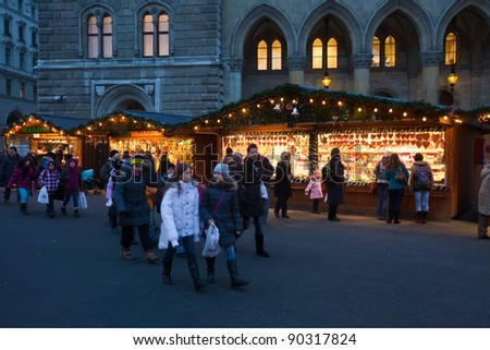 VIENNA, AUSTRIA - NOVEMBER 22: People  walking at  Christmas market near old town hall  in November 22, 2011 in Vienna, Austria.  This market is focused on authentic handicrafts made by local artists