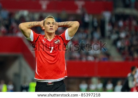 VIENNA,  AUSTRIA - SEPTEMBER 6 Marko Arnautovic (#7, Austria) is disappointed after failing to score during the EURO 2012 soccer game on September 6, 2011 in Vienna, Austria. The game is a draw. - stock photo