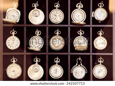 Vienna, Austria - September 21, 2014: Vintage pocket watches displayed in a shopwindow.