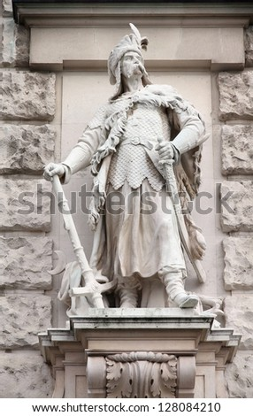 Vienna, Austria - statue in Neue Burg (part of Hofburg palace) facade. Sculpture depicts Magyar or Hungarian chieftain. The Old Town is a UNESCO World Heritage Site.