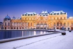 Vienna, Austria. Upper Belvedere snowy winter night reflection, Wien austrian travel background.