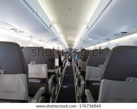 VIENNA, CIRCA SEPTEMBER 2013: seats in the interiors of an aircraft of the Air Berlin company on the flight between Vienna and Duesseldorf, in Vienna, circa September 2013 - stock photo