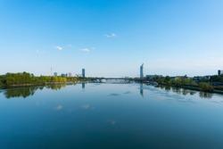 Vienna city view to danube tower and danube river. Beautiful danube island recreation area.