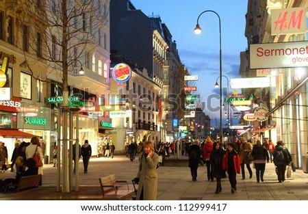 VIENNA- FEB 20: People go on main pedestrian street Kartner Strasse at night on Feb 20, 2012  in Vienna, Austria. Vienna Kartner Strasse street is the main shopping street in Vienna.