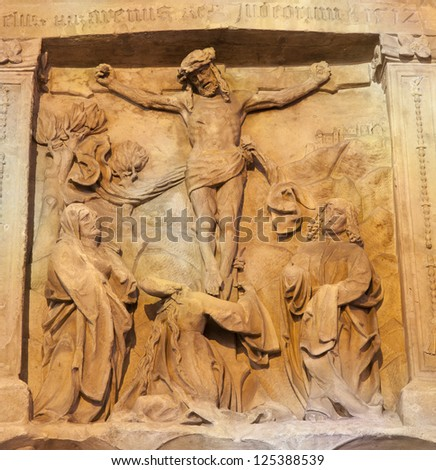 VIENNA - JANUARY 15: Relief of Crucifixion as detail of old tomb on the west facade of st. Stephen cathedral on January 15, 2013 in Vienna.