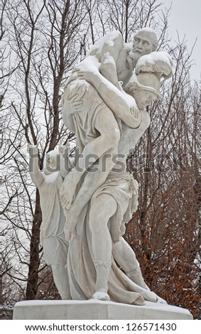 VIENNA - JANUARY 15: Statue of Aeneas escape from Troy from gardens of Schonbrunn palace in winter. Statues was generally made between 1773 and 1780 on January 15, 2013 in Vienna.