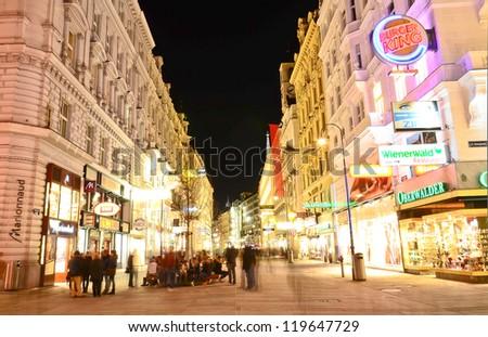 VIENNA- MAR 15: People go on main pedestrian street Kartner Strasse at night on March 15, 2012 in Vienna, Austria. Vienna Kartner Strasse street is the main shopping street in Vienna.