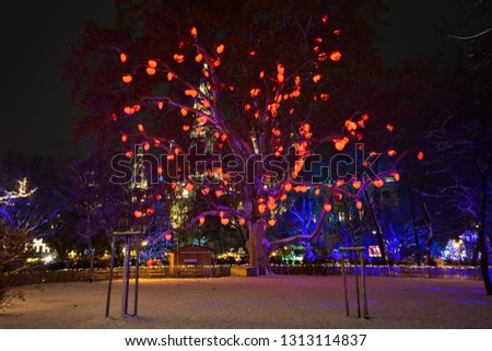 Vienna Rathausplatz with Christmas decorations and lights in trees at famous Christkindlmarkt in Advent. Town hall in background. #1313114837