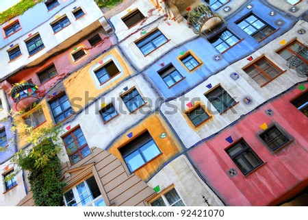 VIENNA - SEPTEMBER 6: Hundertwasser Haus on September 6, 2011 in Vienna. The iconic building by famous architect is one of reasons to visit Vienna. - stock photo