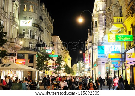 VIENNA - SEPTEMBER 23: Vienna city centre with many tourists at night on September 23, 2012 in Vienna. Tourism generated 8.4% of Austrian gross domestic product and provided 181 thousand jobs