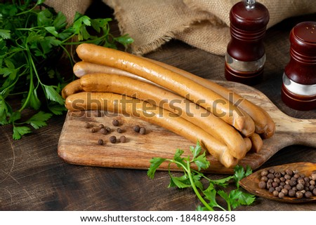 Viennese sausages on a wooden serving Board on a brown wooden table Stock photo ©