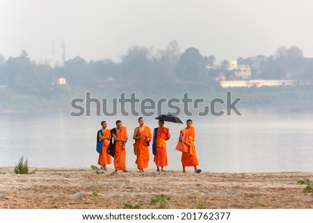 VIENTIANE,LAOS, February 14 : Unidentified Buddhist monks walking on the Mekong river\'s bank in Vientiane,Laos, on February 14, 2012