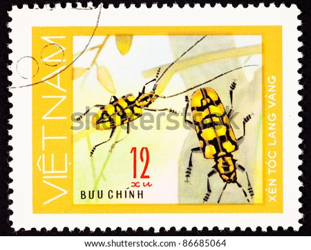 VIETNAM - CIRCA 1977:  A stamp printed in Vietnam shows a pair of yellow beetles with long antenna on some branches, circa 1977.