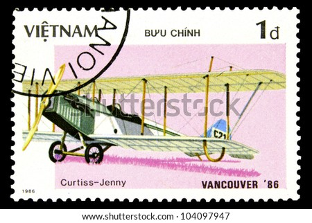 "VIETNAM - CIRCA 1986: A Stamp printed in Vietnam shows Historic Aircraft with the inscription ""Vancouver 86, Curtiss Jenny"", from the series ""Expo '86 World's Fair, Vancouver"", circa 1986"