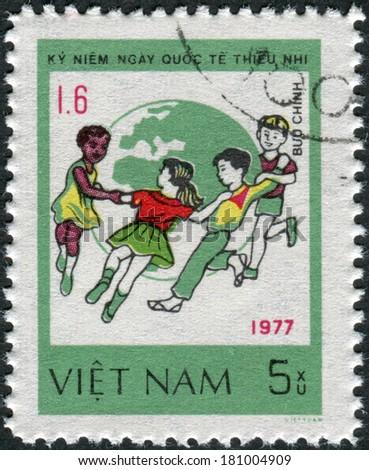 VIETNAM - CIRCA 1980: Postage stamp printed in Vietnam, dedicated to International Children\'s Day (1977), shows Children dance around Globe, circa 1980