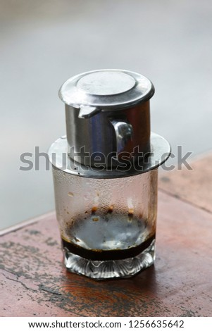 Vietnam Coffee cup, wood table background