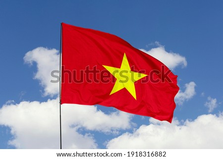 Vietnam flag isolated on the blue sky with clipping path. close up waving flag of Vietnam. flag symbols of Vietnam.
