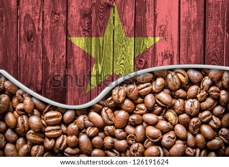 Vietnam flag on wooden background and coffee beans wave