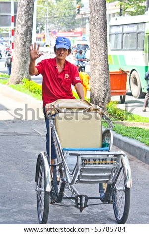 VIETNAM - JUNE 10: A friendly cyclo driver along the roads of Ho Chi Minh City in Vietnam. June 10, 2010 Ho Chi Minh City, Vietnam