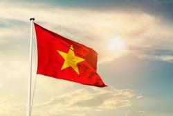 Vietnam national flag cloth fabric waving on the sky with beautiful sun light - Image