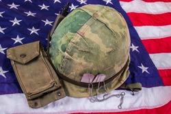 Vietnam Vet Helmet, Dog Tags & Ammo Pouch On American Flag