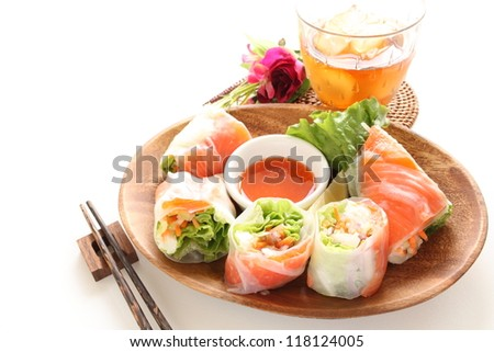 Vietnamese cuisine , raw spring raw with smoked salmon and vegetable on traditional wooden plate