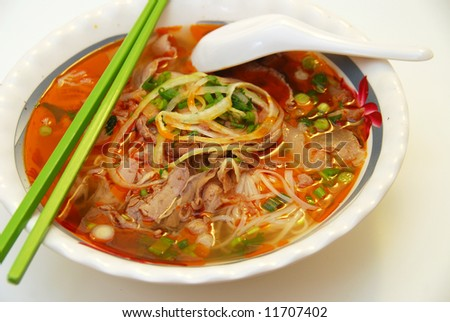vietnamese food: closeup of satay beef noodle soup