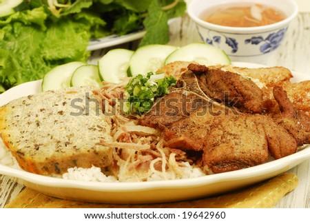 Vietnamese food on vintage table - stock photo