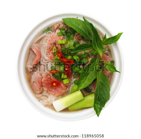 Vietnamese food , rice noodle soup with sliced rare beef - stock photo