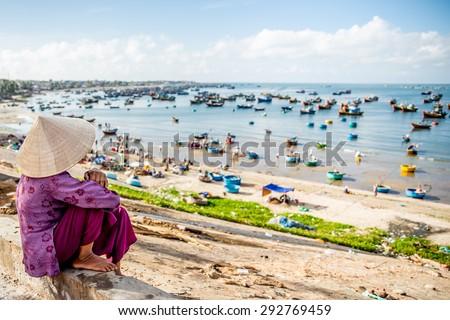 Vietnamese Girl beside the beach , Slow life , Mui Ne Fishing village