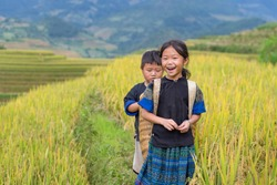 Vietnamese Hmong children smiling in rice terrace river side o at mu cang chai district,Yenbai province, northwest of Vietnam.