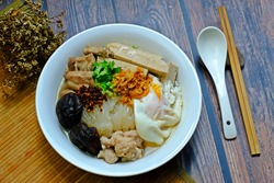 Vietnamese rice noodle soup with pork spare ribs, Vietnamese sausage, mince, minced pork, Shiitake mushrooms and Onsen tamago or soft-boiledhot spring eggs (Kuey Jab Yuen).