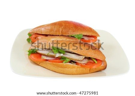 Vietnamese sandwiches on plate isolated over white