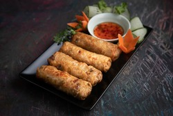 Vietnamese spring rolls with sweet sauce and cucumber