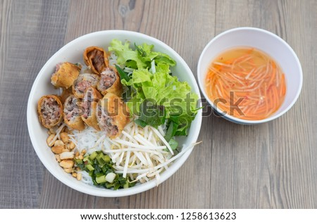 Vietnamese spring rolls with vermicelli (Bun cha gio): This a southern meal is totally different from bun cha of northern Vietnam. Fried spring rolls of bean or meat are cut and mixed with vegetable