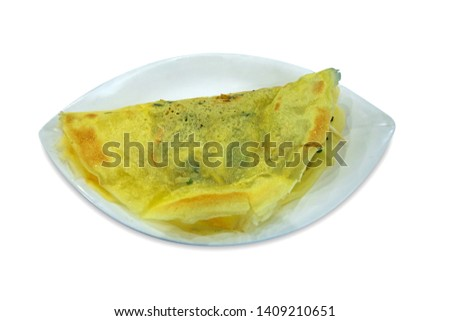 Vietnamese stuffed crispy omelette or stuffed crispy omelette fried in the hot pan, stuff with beansprout, Groundnut and tofu