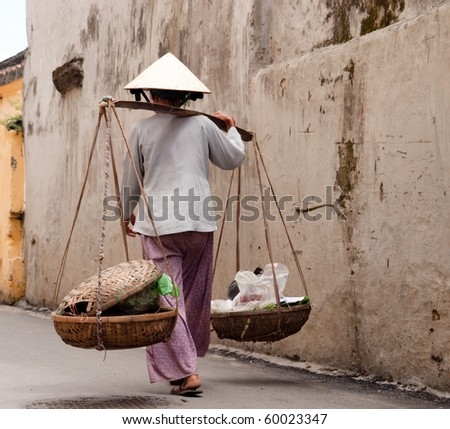 Vietnamese woman in a narrow street