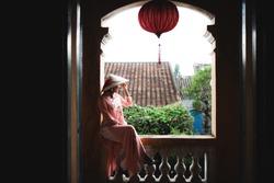 "Vietnamese woman in ""Ao Dai"" traditional dress of vietnam"