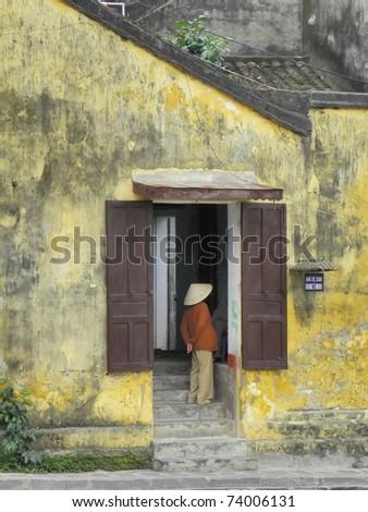 vietnamese  woman in doorway in hoi an